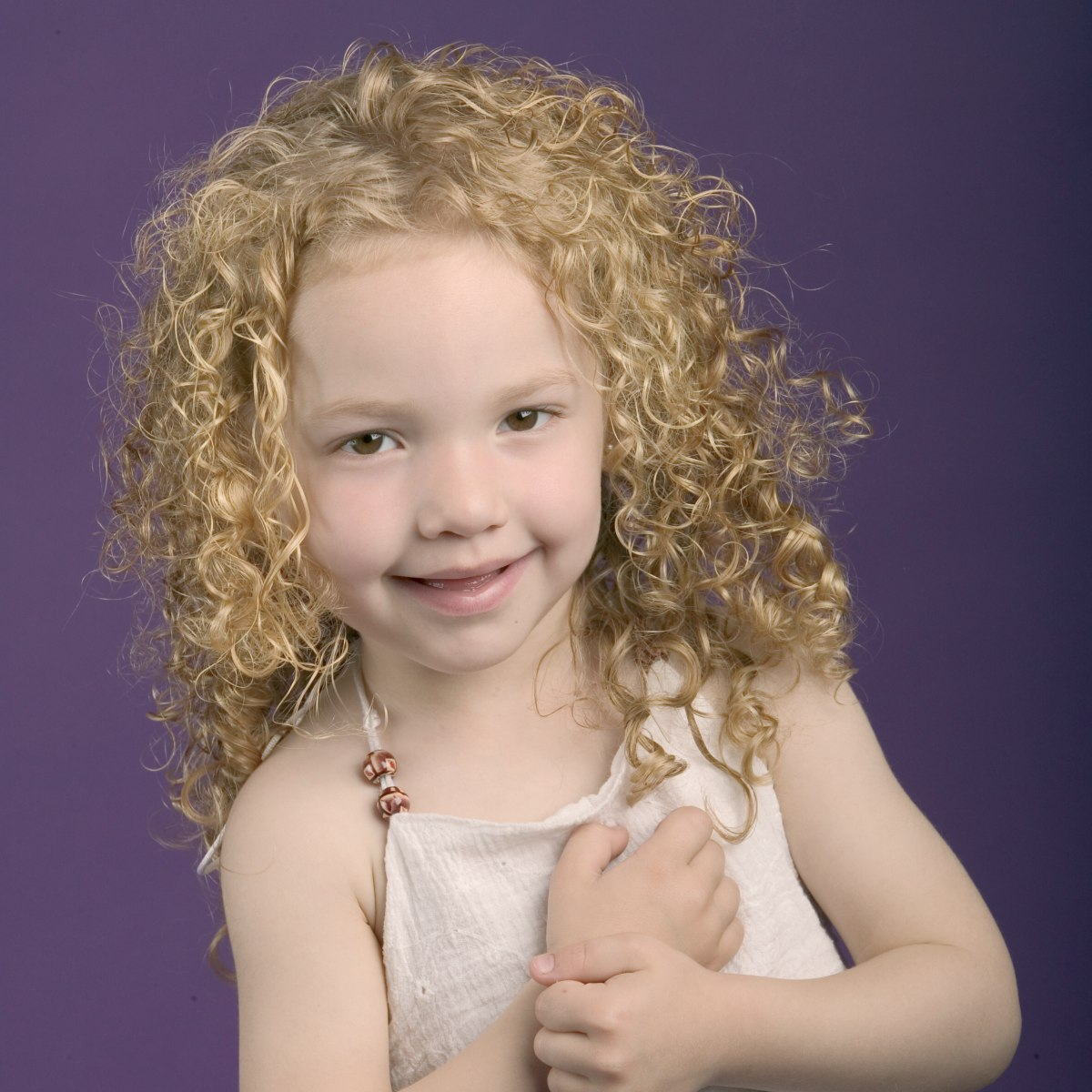 spiraling curls for a little girl simple hair styling
