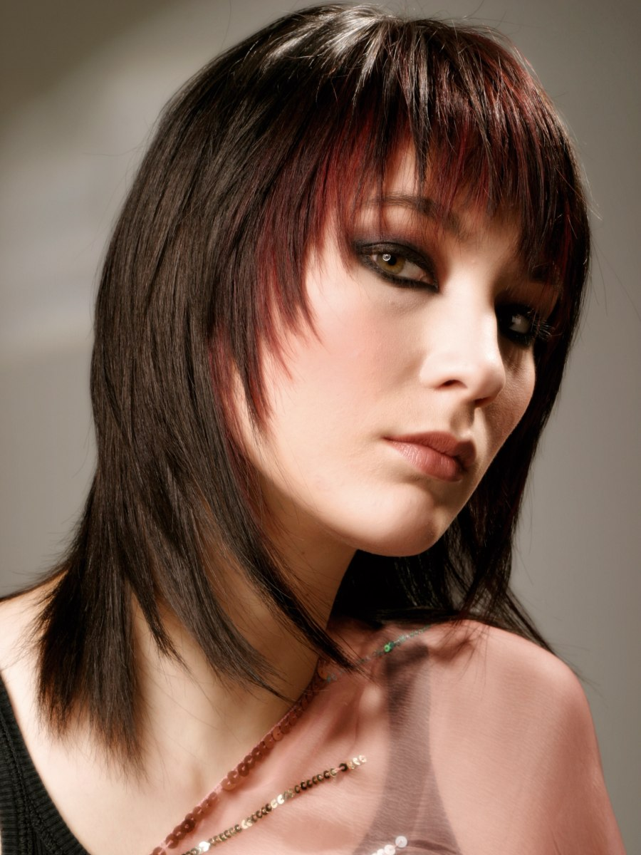 Tapered Haircut With Long Tendrils Along The Sides Of The Face