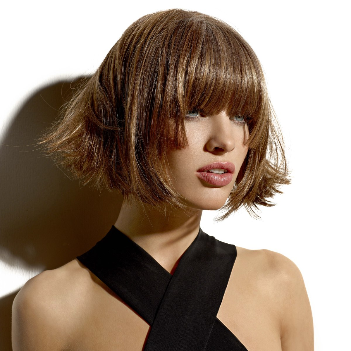 Short chin length trapeze shape bob with flipped out ends