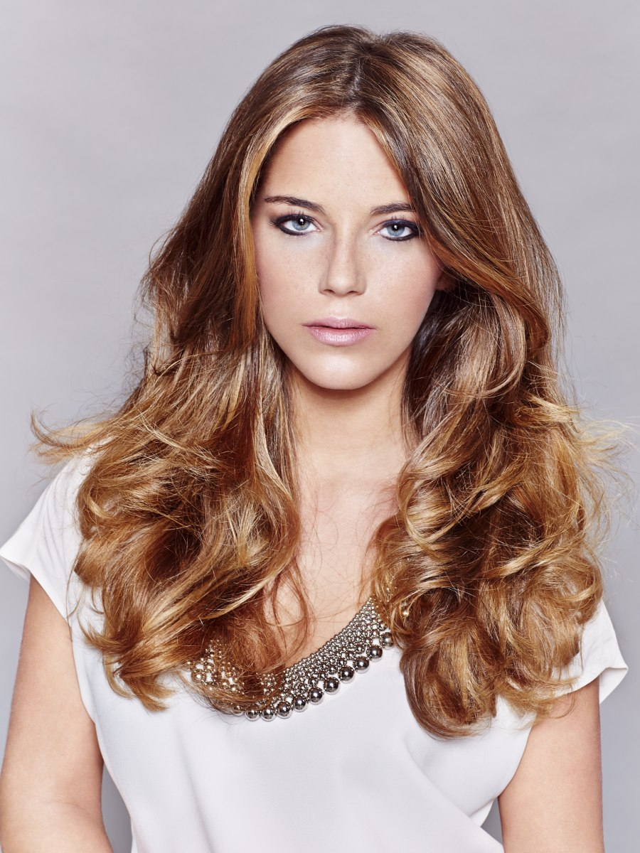 classic long hairstyle for dark blonde hair with lighter accents