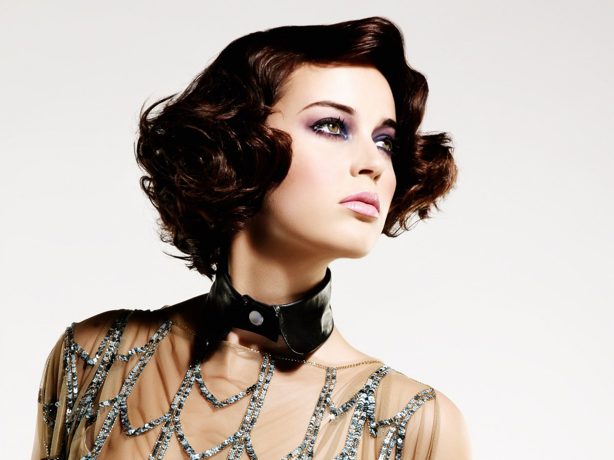 Short haircut with curls and waves draped around the face ...