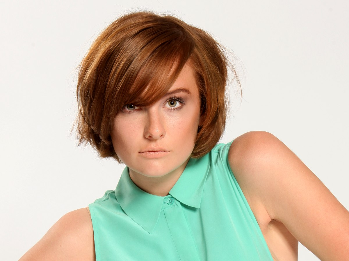 Short layered bob with rounded sides and bangs across the