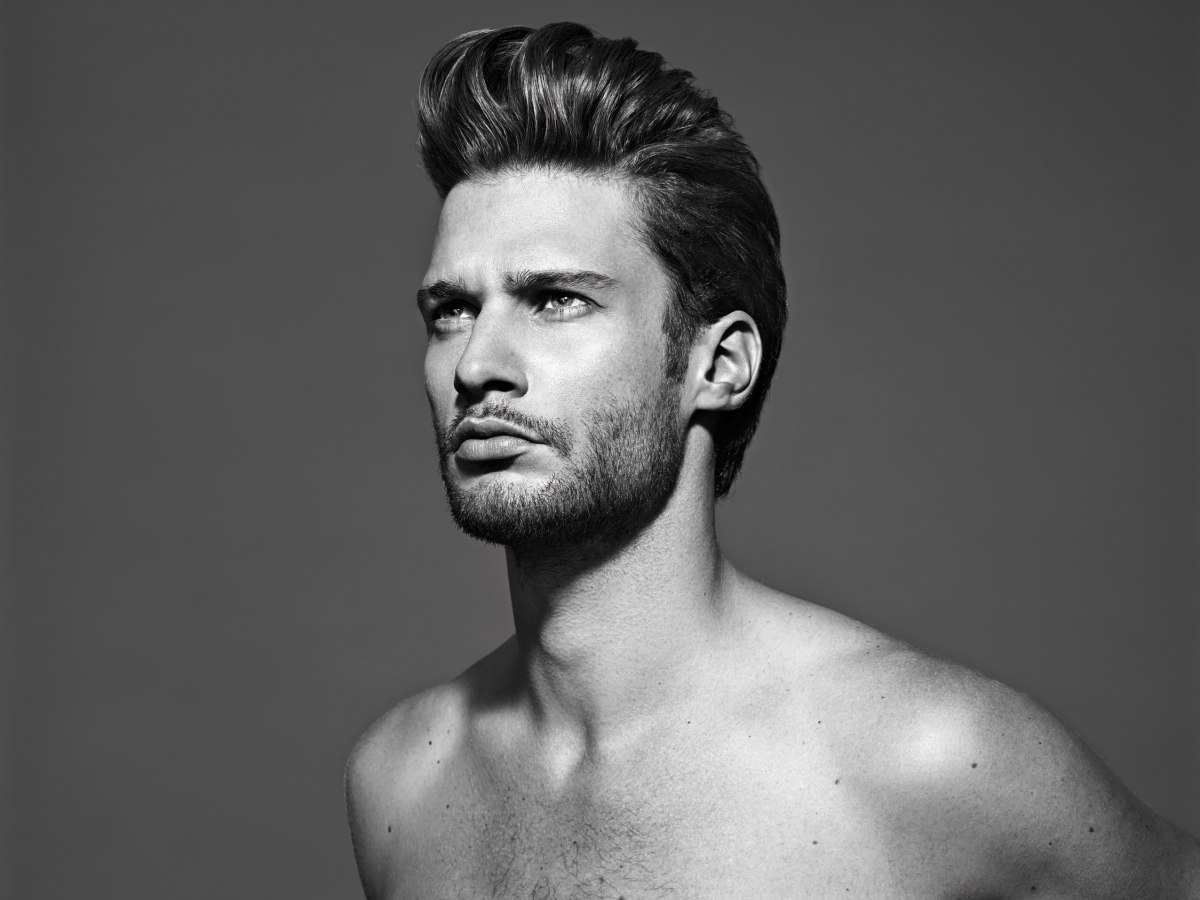 Astounding Men39S Hairstyle With Short Sides Styled With Gel And A Tall Quiff Short Hairstyles Gunalazisus