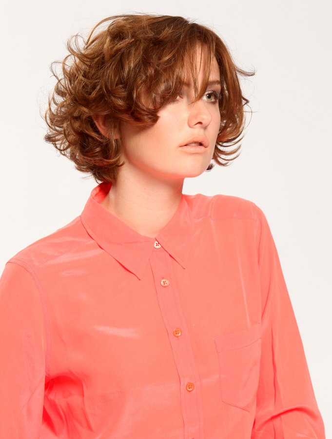 Short Curly Hairstyle With Layers And A Silk Blouse With A
