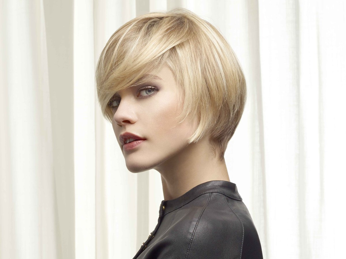 short haircut with a short neck and several shades of blonde