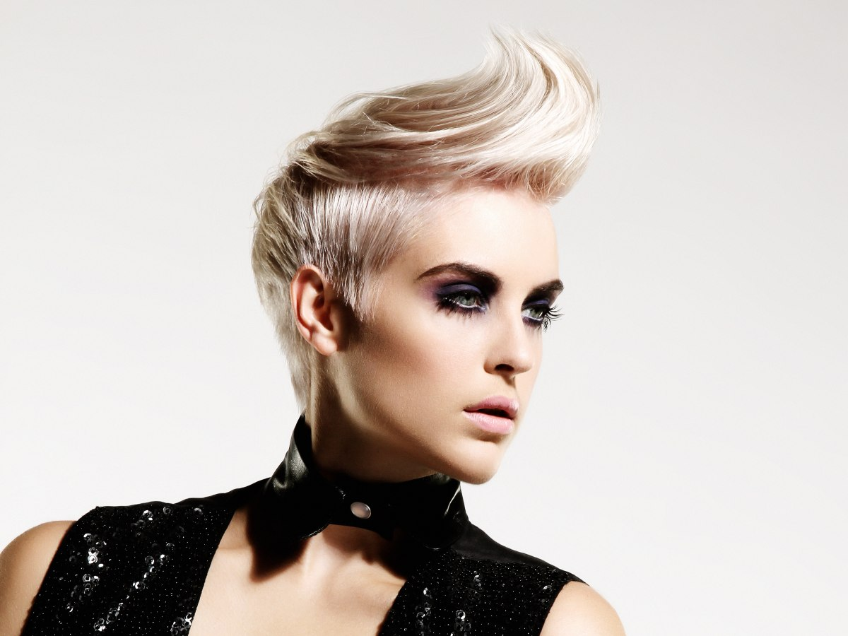 Blonde haircut with short sides and longer top hair
