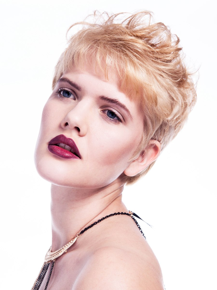 Short Haircut With A Thin Straight Fringe That Reaches To