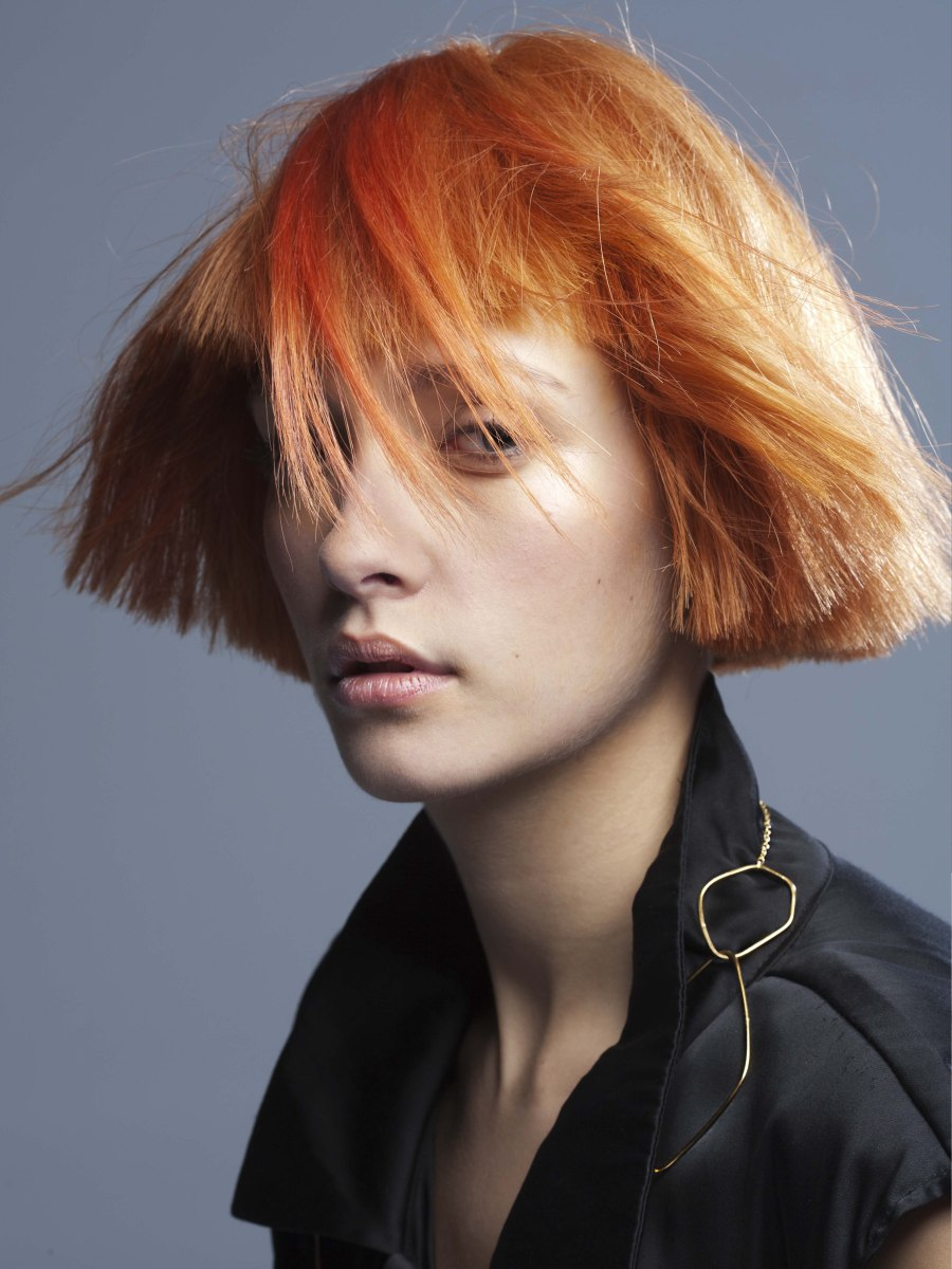 Short Jaw Length Red Hairstyle With A Triangular Shape And