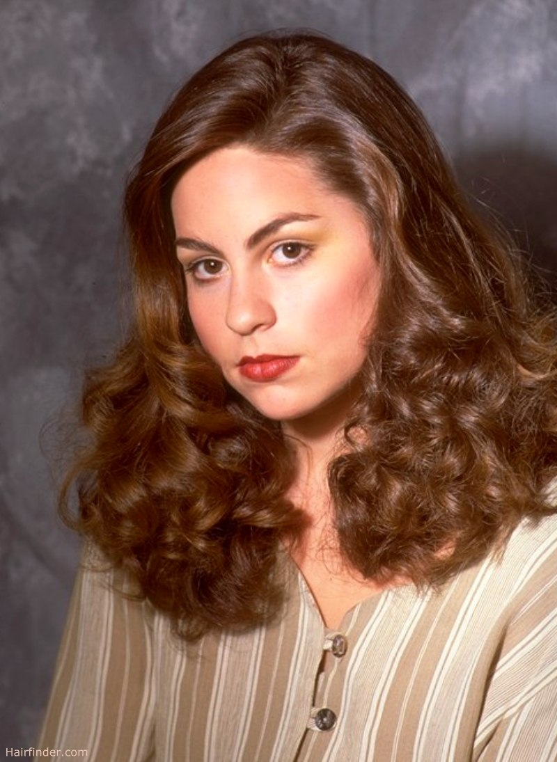 Feminine 40s era hairstyle with curls