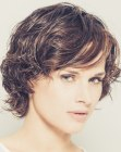 Short layered hair with bangs and wet look styling