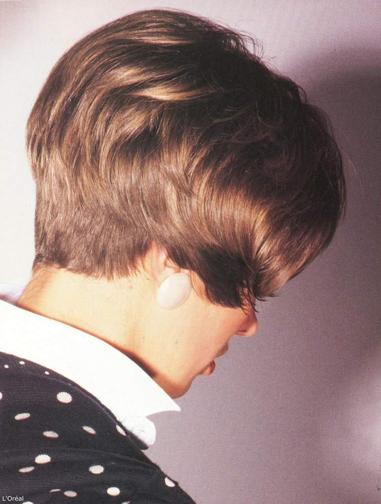 Short eighties hairstyle with the hair cut very short at the back