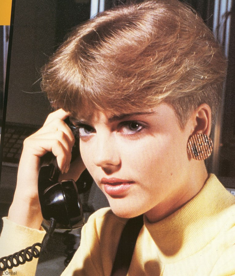 typical 1980s short ladies haircut with the hair clippered very ...