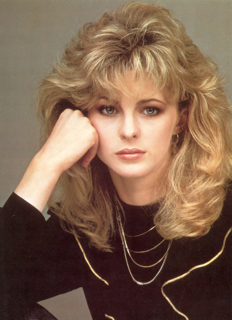Romantic Long 1980s Hairstyle With Layers Around The Bangs