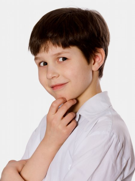 Little boys haircut with longer top hair on the crown