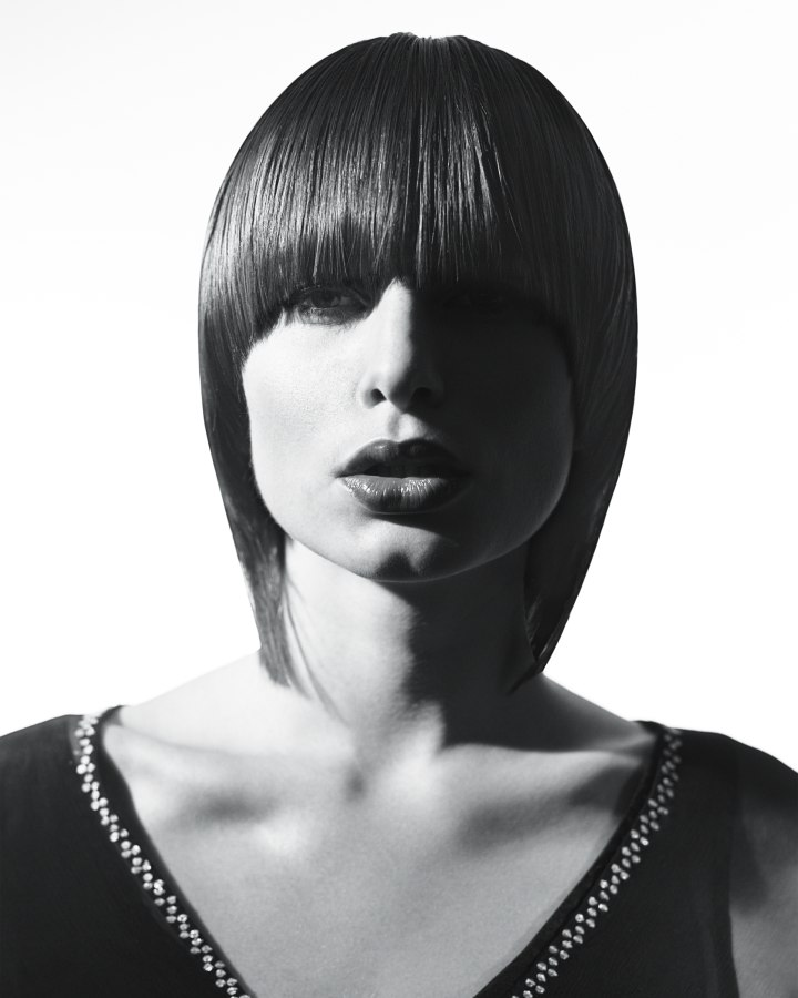 60s Bob Hairstyle With A Low Thick Fringe