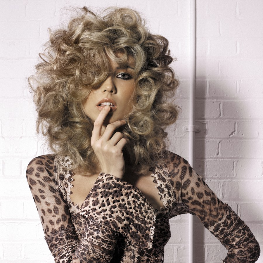 Long Hairstyle With Large Curls Created With Rollers