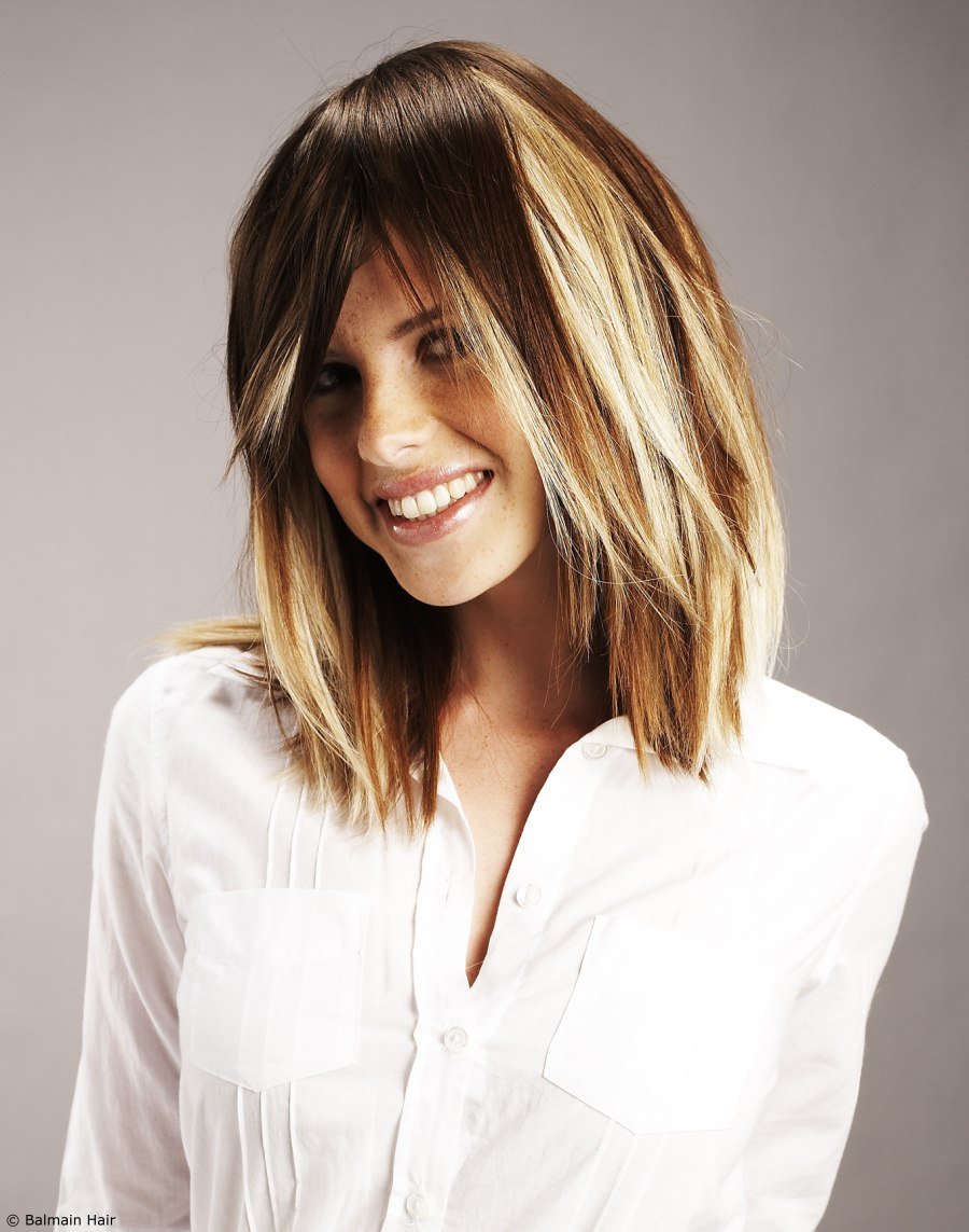 Hair Extensions Applied To Add Fullness And Swaths Of