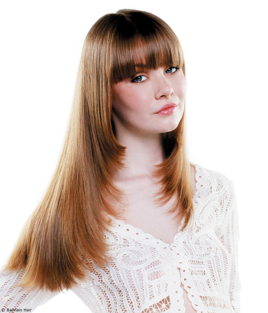 Hairstyle with hair extensions for long hair with feathered ends