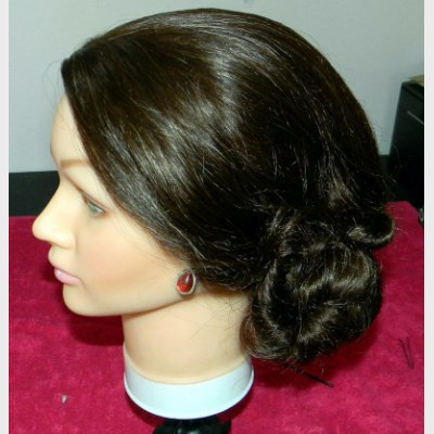 Hair in an up-style with a double twist