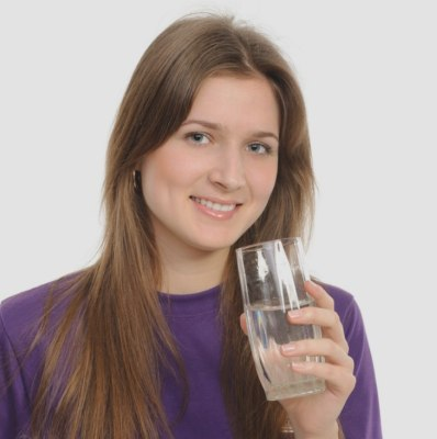 Woman who is drinking water for healthy hair